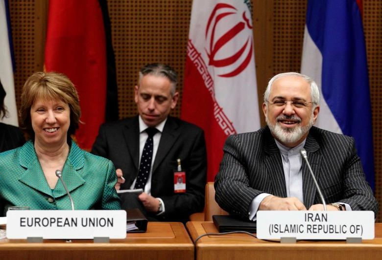 European Union foreign policy chief Catherine Ashton (L) and Iranian Foreign Minister Mohammad Javad Zarif smile at the start of a conference in Vienna March 18, 2014. REUTERS/Heinz-Peter Bader