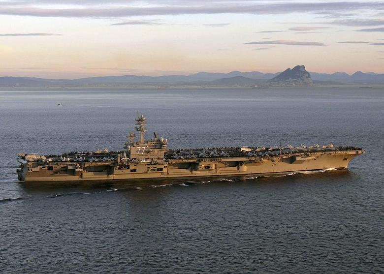 The aircraft carrier USS George H. W. Bush transits the Strait of Gibraltar into the Mediterranean Sea in this February 27, 2014 picture provided by the U.S. Navy.  REUTERS/U.S. Navy/Lt. Juan David Guerra/Handout via Reuters