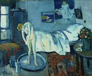 "Pablo Picasso's painting ""The Blue Room"" is seen in this undated handout photo. REUTERS/The Phillips Collection/Handout"