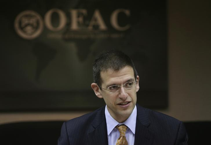 Office of Foreign Assets Control (OFAC) Director Adam Szubin and his staff (not pictured) meet at the U.S. Treasury Department in Washington March 26, 2014.  REUTERS/Gary Cameron