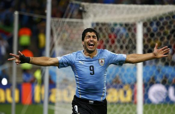 Uruguay's Luis Suarez celebrates after scoring his team's second goal against England during their 2014 World Cup Group D soccer match at the Corinthians arena in Sao Paulo June 19, 2014. REUTERS/Tony Gentile