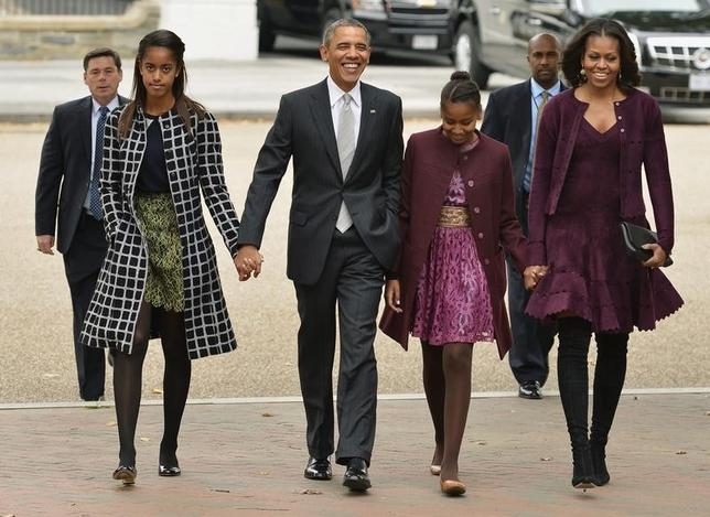 U.S. President Barack Obama (2nd L) and First Lady Michelle Obama (R) hold hands with daughters Malia (L) and Sasha as they walk from the White House to St. John's Church for Sunday services, in Washington, October 27, 2013.    REUTERS/Mike Theiler