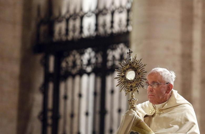 Pope Francis leads the feast of Corpus Christi (Body of Christ) at St. Maria Maggiore Basilica in Rome June 19, 2014. REUTERS/Remo Casilli