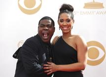 "Actor Tracy Morgan from NBC's sitcom ""30 Rock"" and wife, Sabina Morgan, arrive at the 65th Primetime Emmy Awards in Los Angeles September 22, 2013. REUTERS/Mario Anzuoni/Files"