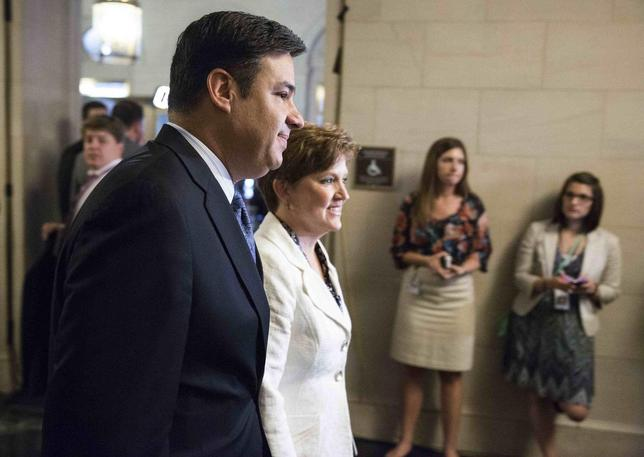 Raul Labrador (R-ID) (L) arrives for House Republican leadership elections in the Longworth House Office Building on Capitol Hill in Washington, June 19, 2014. REUTERS/Joshua Roberts
