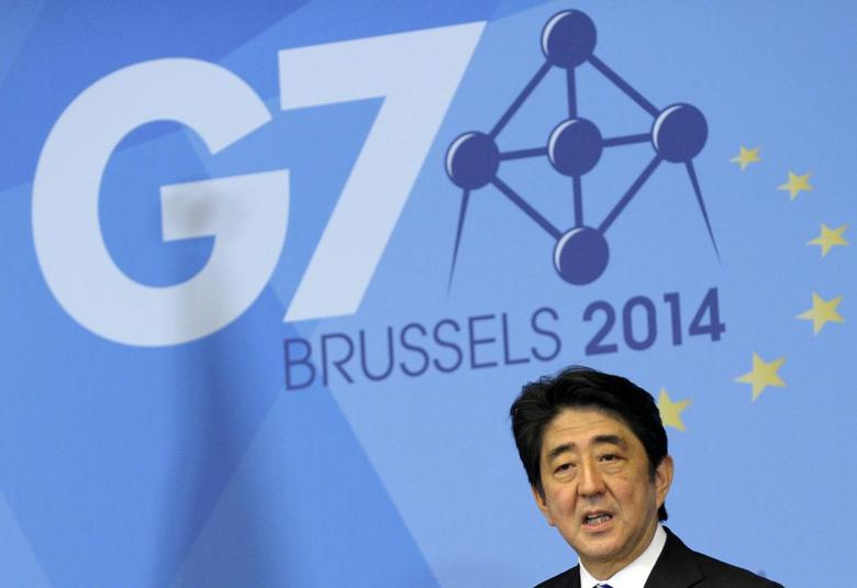 Japan's Prime Minister Shinzo Abe holds a news conference at the end of the G7 leaders meeting at European Council headquarters in Brussels June 5, 2014. REUTERS/Laurent Dubrule