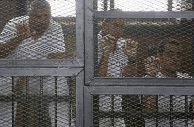 Egypt jails Al Jazeera journalists, U.S. calls sentenc...