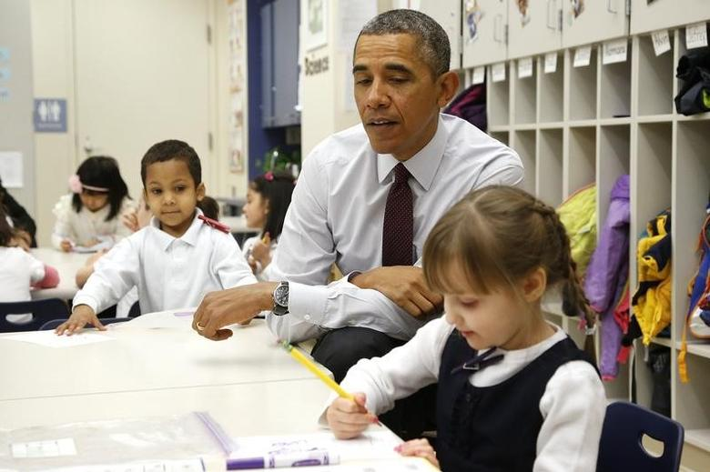 U.S. President Barack Obama interacts with children at Powell Elementary School in Washington March 4, 2014.  REUTERS/Jonathan Ernst