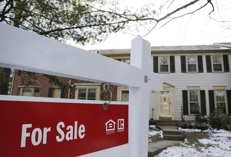 A home for sale sign hangs in front of a house in Oakton, on the day the National Association of Realtors issues its Pending Home Sales for February report, in Virginia March 27, 2014. REUTERS/Larry Downing