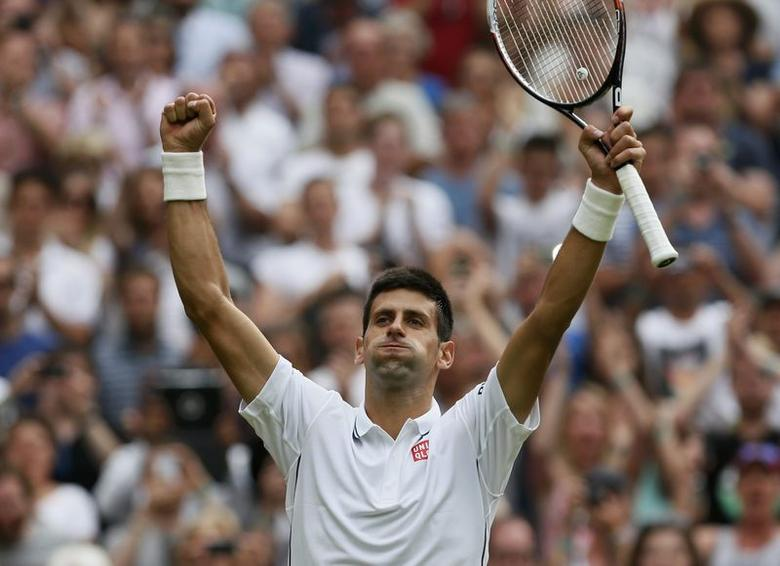 Novak Djokovic of Serbia reacts after defeating Andrey Golubev of Kazakhstan in their men's singles tennis match at the Wimbledon Tennis Championships, in London June 23, 2014. REUTERS/Stefan Wermuth
