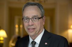 Canada's Finance Minister Joe Oliver poses for a portrait in the Canadian High Commissioner's official residence in London June 23, 2014. REUTERS/Neil Hall