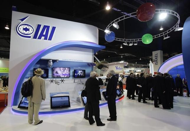 Trade visitors gather at the Israel Aerospace Industries (IAI) exhibition booth at the Singapore Airshow in Singapore February 14, 2012.  REUTERS/Tim Chong