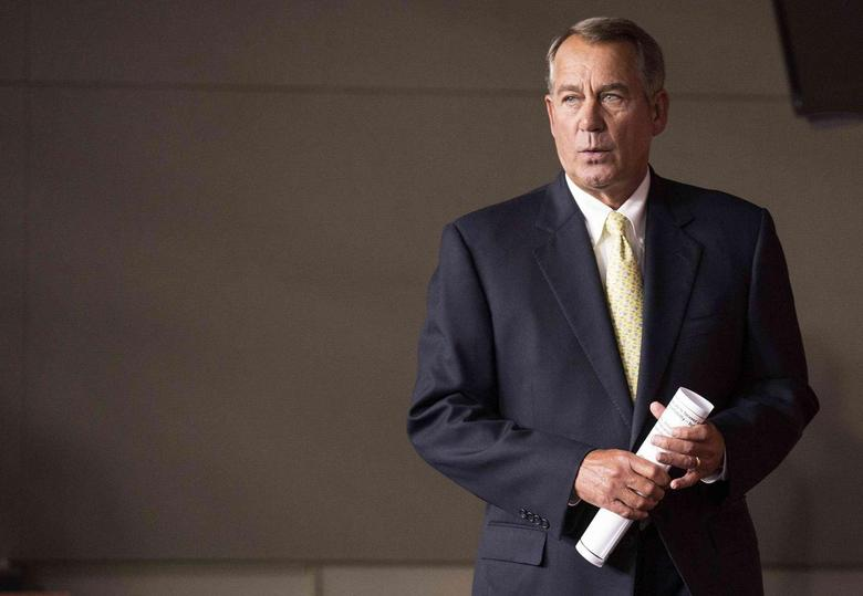 Speaker of the House John Boehner (R-OH) arrives for a news conference on Capitol Hill in Washington June 19, 2014. REUTERS/Joshua Roberts