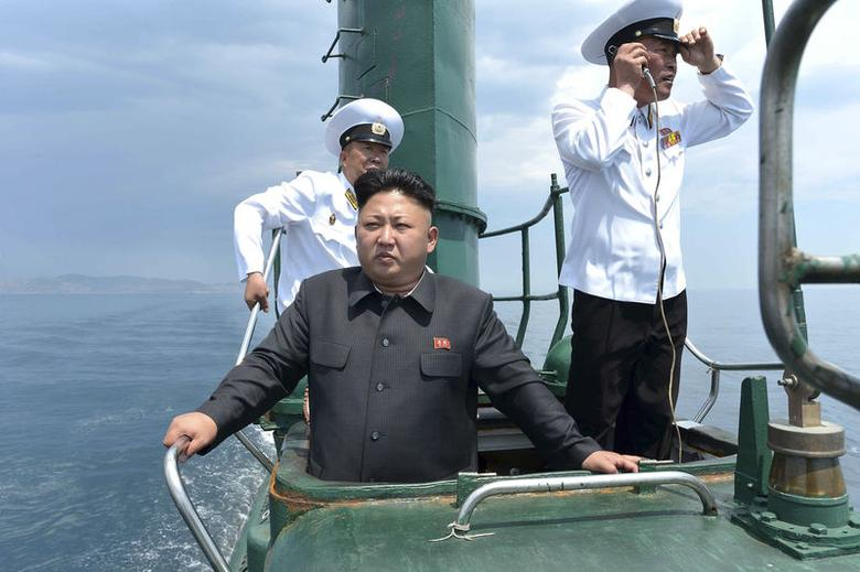 North Korean leader Kim Jong Un (front) stands on the conning tower of a submarine during his inspection of the Korean People's Army (KPA) Naval Unit 167 in this undated photo released by North Korea's Korean Central News Agency (KCNA) in Pyongyang June 16, 2014. REUTERS/KCNA