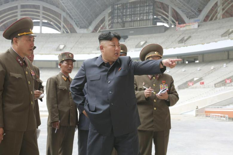 North Korean leader Kim Jong Un gives field guidance to the remodelling site of the May Day Stadium in this undated photo released by North Korea's Korean Central News Agency (KCNA) in Pyongyang June 20, 2014. REUTERS/KCNA