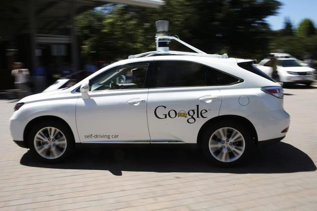 A Google self-driving vehicle drives around the parking lot at the Computer History Museum after a presentation in Mountain View, California May 13, 2014. REUTERS/Stephen Lam