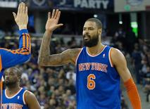 Mar 26, 2014; Sacramento, CA, USA; New York Knicks center Tyson Chandler (6) high fives teammates after a basket against the Sacramento Kings during the second quarter at Sleep Train Arena. Kelley L Cox-USA TODAY Sports