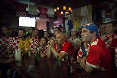 Croatian fans react to being behind late in their opening match against Brazil in the Astoria neighborhood of Queens.     REUTERS/Andrew Kelly
