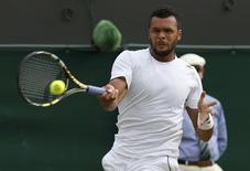 Jo-Wilfried Tsonga of France hits a return against Sam Querrey of the U.S. during their men's singles tennis match on No.2 court at the Wimbledon Tennis Championships in London June 26, 2014. REUTERS/Suzanne Plunkett