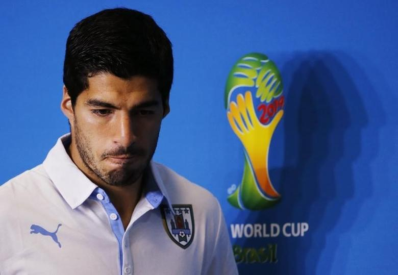 Uruguay's national soccer team player Luis Suarez attends a news conference prior a training session at the Dunas Arena soccer stadium in Natal, June 23, 2014. REUTERS/Carlos Barria
