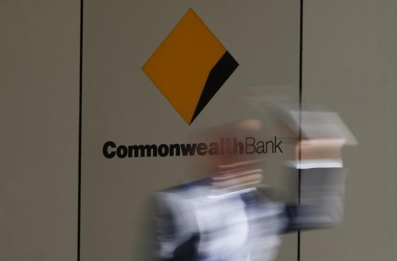 A man leaves the Commonwealth Bank of Australia building in central Sydney August 14, 2013. REUTERS/Daniel Munoz