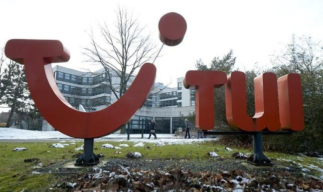 People pass the logo of German travel company TUI AG at the company's headquarters in Hanover, February 13, 2013.  REUTERS/Fabian Bimmer