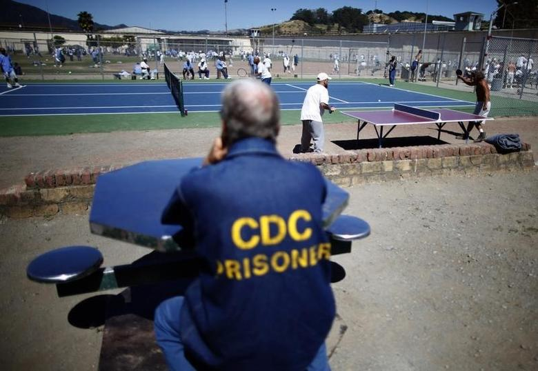 Prisoners play table tennis in the exercise yard at San Quentin state prison in San Quentin, California, June 8, 2012.  Picture taken June 8, 2012. REUTERS/Lucy Nicholson