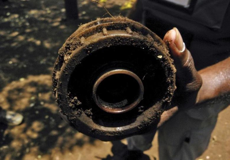 A deminer working for the Swiss Foundation for Mine Action (FSD) shows an anti-personnel landmine in Mannar district, Sri Lanka September 8, 2011. REUTERS/ALERTNET/Nita Bhalla