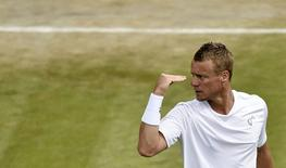 Lleyton Hewitt of Australia gestures during his men's singles match against Jerzy Janowicz of Poland at the Wimbledon Tennis Championships, in London June 27, 2014. REUTERS/Toby Melville