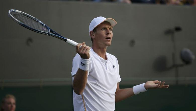 Tomas Berdych of Czech Republic reacts during his men's singles tennis match against Marin Cilic of Croatia on Court 1 at the Wimbledon Tennis Championships in London June 27, 2014.    REUTERS/Max Rossi