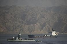 An Israeli Navy boat escorts the Panamanian-flagged cargo vessel Klos C into the Israeli port of Eilat on Saturday after seizing it in the Red Sea on Wednesday, March 8, 2014. REUTERS/Finbarr O'Reilly