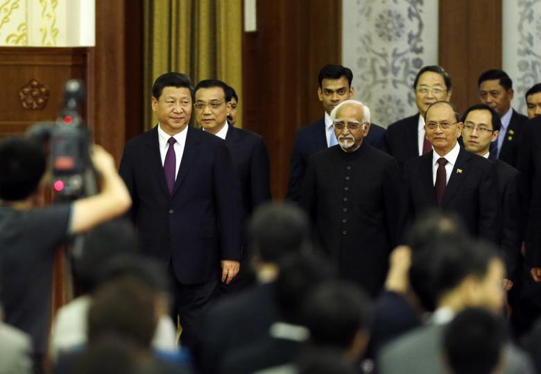 China's President Xi Jinping (L), Premier Li Keqiang, Myanmar's President Thein Sein (R, front) and India's Vice President Mohammad Hamid Ansari (C,front) arrive for a conference marking the 60th anniversary of the ''Five Principles of Peaceful Coexistence'', known in India as the Panchsheel Treaty, a set of principles to govern relations between states, at the Great Hall of the People, in Beijing, June 28, 2014. REUTERS/Jason Lee
