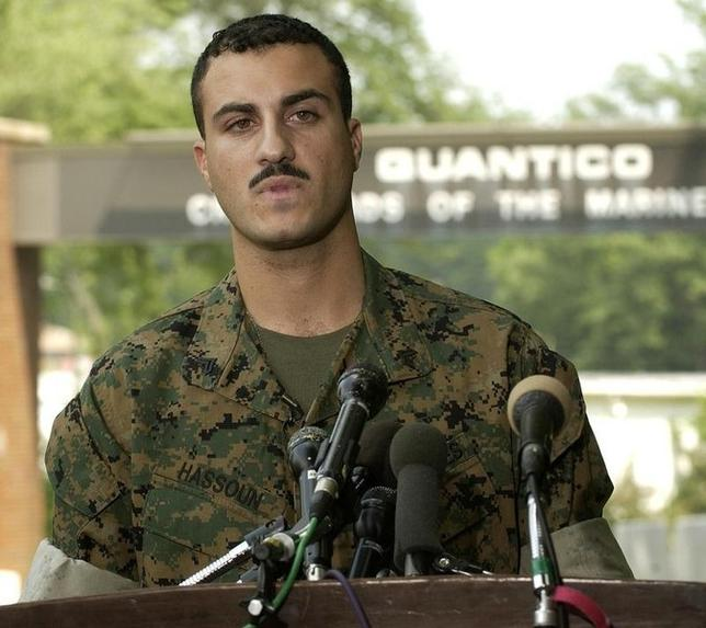 U.S. Marine Corps Corporal Wassef Ali Hassoun reads a prepared statement outside the gate at Quantico Marine Corps Base in Northern Virginia, [35 miles south of Washington], July 19, 2004. - RTXMRZH