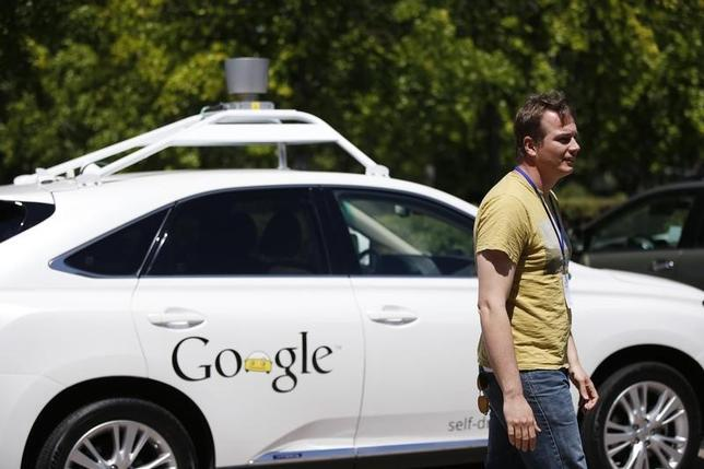 Chris Urmson, director of Google's Self-Driving Car Project, stands in front of a self-driving car at the Computer History Museum after a presentation in Mountain View, California May 13, 2014. REUTERS/Stephen Lam/Files