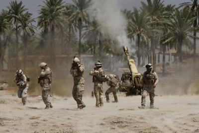 As caliphate declared, Iraqi troops battle for Tikrit