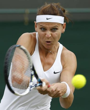 Lucie Safarova of the Czech Republic hits a return to Dominikia Cibulkova of Slovakia during their women's singles tennis match at the Wimbledon Tennis Championships, in London June 27, 2014. REUTERS/Suzanne Plunkett