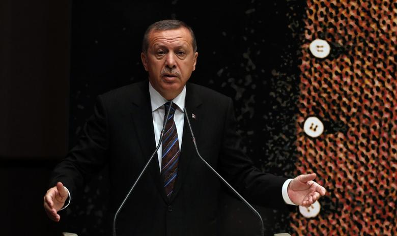 Turkey's Prime Minister Tayyip Erdogan addresses the audience at a meeting at his ruling Ak Party (AKP) headquarters in Ankara June 25, 2014. REUTERS/Umit Bektas
