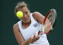 Barbora Zahlavova Strycova of the Czech Republic hits a return to Caroline Wozniacki of Denmark during their women's singles tennis match at the Wimbledon Tennis Championships, in London June 30, 2014. REUTERS/Stefan Wermuth