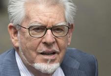 Entertainer Rolf Harris arrives at Southwark Crown Court in London June 27, 2014. REUTERS/Neil Hall