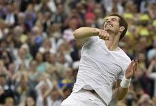 Andy Murray of Britain throws his sweatband into the crowd after defeating Kevin Anderson of South Africa in their men's singles tennis match at the Wimbledon Tennis Championships, in London June 30, 2014.               REUTERS/Toby Melville