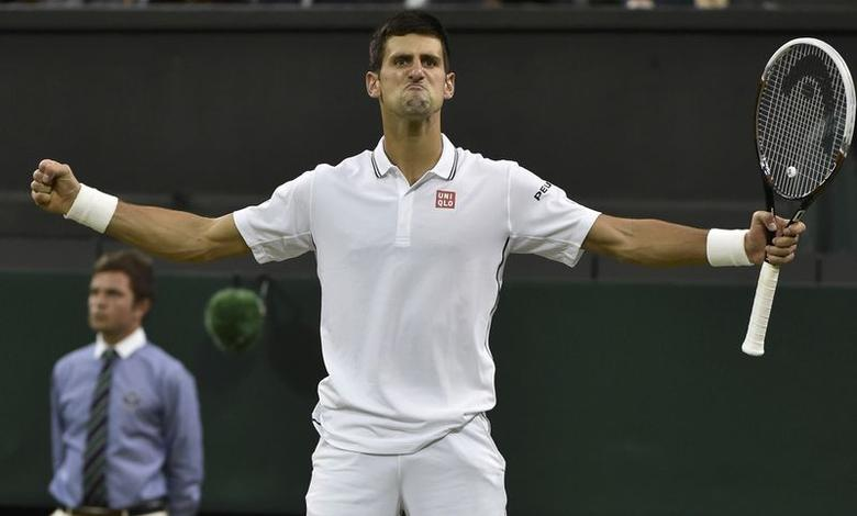Novak Djokovic of Serbia reacts after defeating Jo-Wilfried Tsonga of France in their men's singles tennis match at the Wimbledon Tennis Championships, in London June 30, 2014.                      REUTERS/Toby Melville