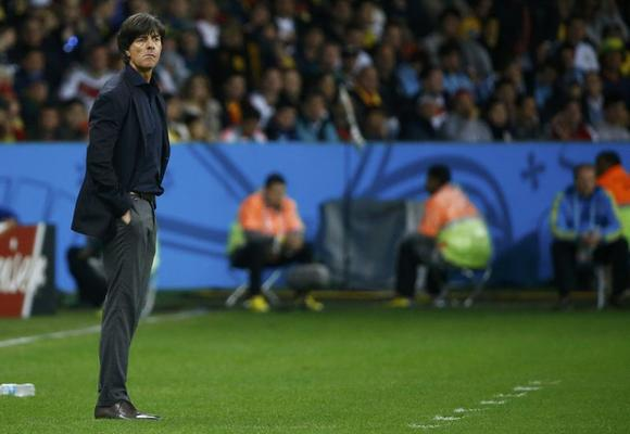 Germany's coach Joachim Loew watches as his team plays against Algeria during their 2014 World Cup round of 16 game at the Beira Rio stadium in Porto Alegre June 30, 2014. REUTERS/Stefano Rellandini