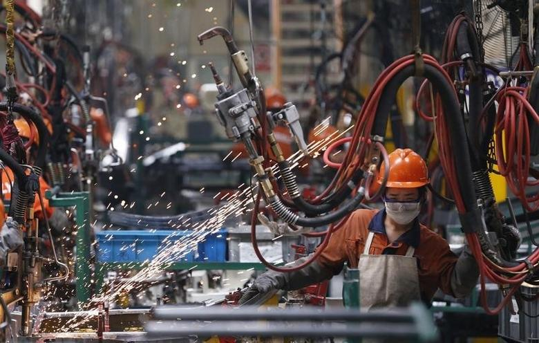 An employee works at a production line inside a Geely factory in Ningbo, Zhejiang province May 15, 2014. REUTERS/Stringer
