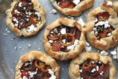 "Heirloom Tomato Galettes with Urfa Chilies, Mint and Ricotta Salata, a dish that appears in chef Aliya LeeKong's first cookbook ""Exotic Tables"", is shown in this handout photo taken August 14, 2012 and provided by LeeKong on June 30, 2014.      REUTERS/Aliya LeeKong/Handout via Reuters"