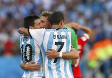 Argentina's Lionel Messi, Angel Di Maria (7) and Lucas Biglia (C) celebrate after extra time in the 2014 World Cup round of 16 game between Argentina and Switzerland at the Corinthians arena in Sao Paulo July 1, 2014. REUTERS/Eddie Keogh