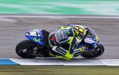 Yamaha MotoGP rider Valentino Rossi of Italy steers his bike during the Dutch Grand Prix in Assen June 28, 2014. REUTERS/Michael Kooren