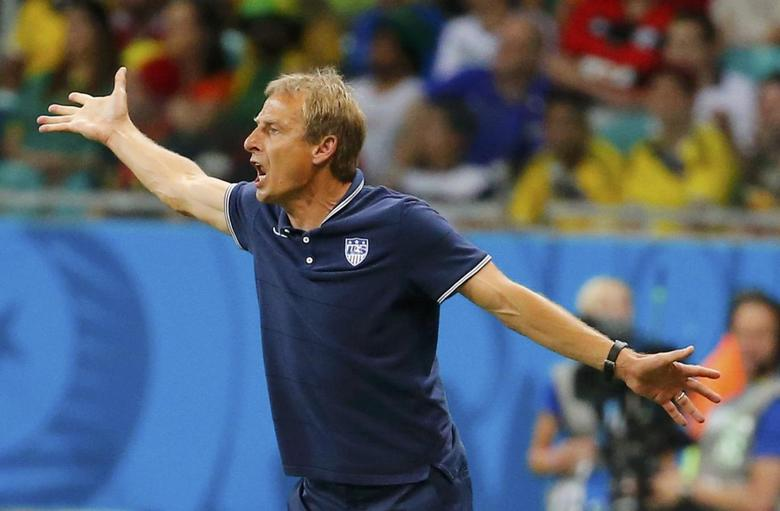U.S. coach Juergen Klinsmann gestures during extra time in their 2014 World Cup round of 16 game against Belgium at the Fonte Nova arena in Salvador July 1, 2014. REUTERS/Yves Herman