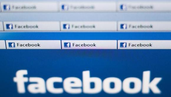 Facebook website pages opened in an internet browser are seen in this photo illustration taken in Lavigny May 16, 2012. REUTERS/Valentin Flauraud/Files