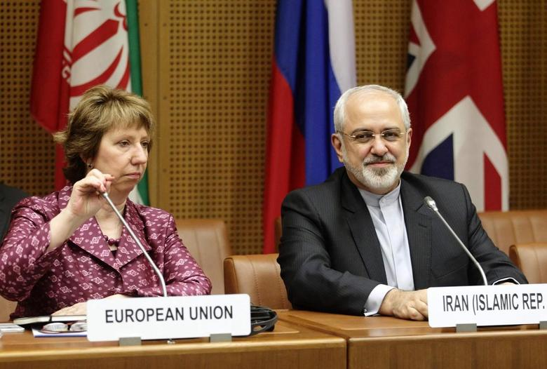 European Union Foreign Policy Chief Catherine Ashton (L) and Iranian Foreign Minister Mohammad Javad Zarif wait to begin talks in Vienna July 3, 2014. REUTERS/Heinz-Peter Bader