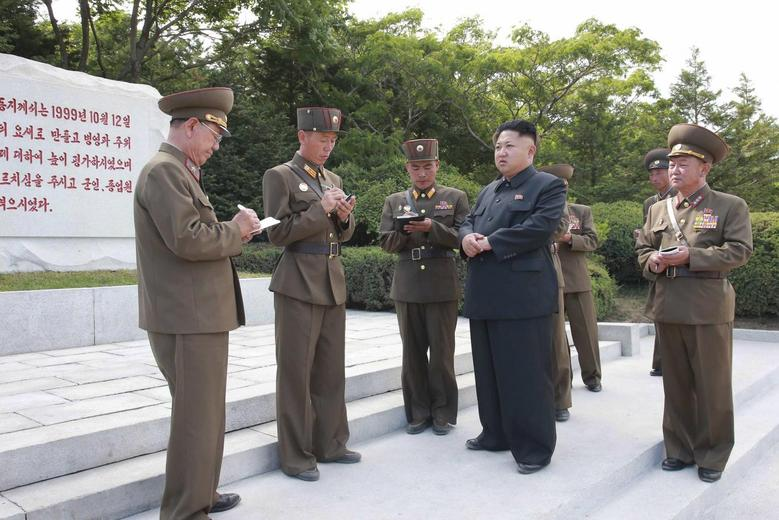 North Korean leader Kim Jong Un carries out an inspection of the Hwa Islet Defence Detachment standing guard over a forward post off the east coast of the Korean peninsula, in this undated photo released by North Korea's Korean Central News Agency (KCNA) in Pyongyang on July 1, 2014. REUTERS/KCNA